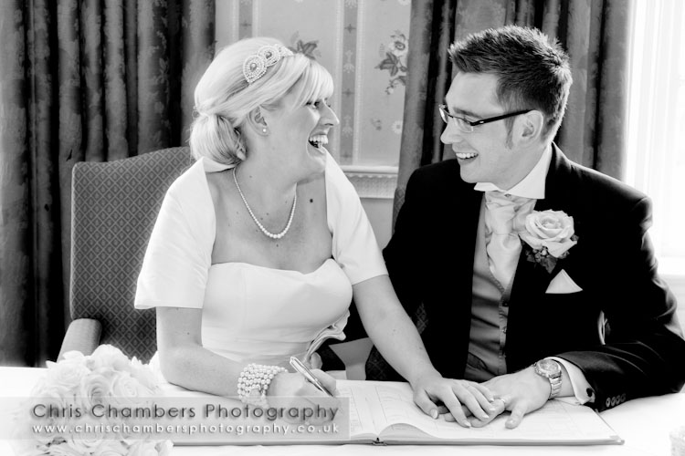 Signing the wedding register at Hazlewood Castle