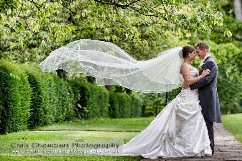 Bride's veil blows in the wind. Hazlewood Castle weddings. Wedding photography Chris Chambers