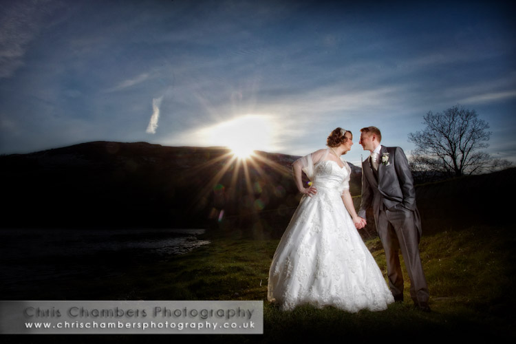 Bride and groom kissing at Burnsall