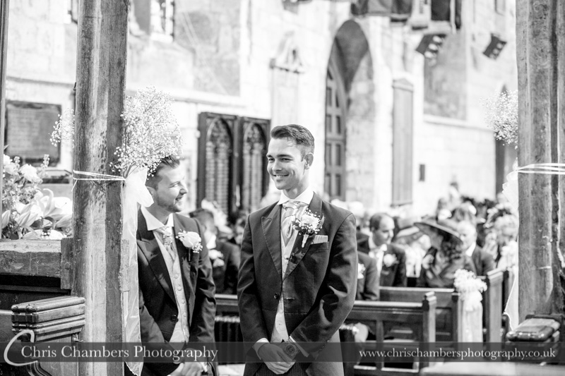 groom waiting for the bride - wedding ceremony at St Mary's church in Blyth Nottinghamshire - wedding photographer at Hodsock Priory and Blyth Church