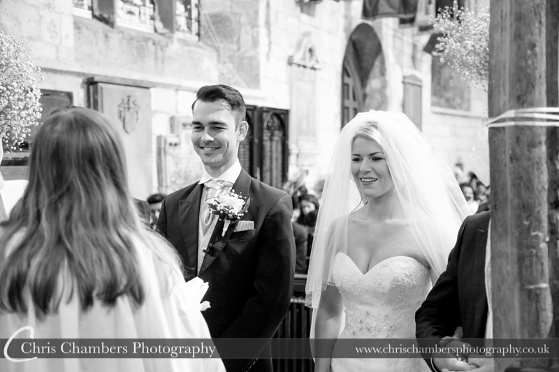 bride and groom during the wedding ceremony at St Mary's church in Blyth Nottinghamshire