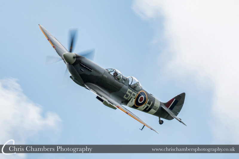 Spitfire flying display at Hodsock Priory for Wes and Sam's wedding day. Spitfire flypast at weddings