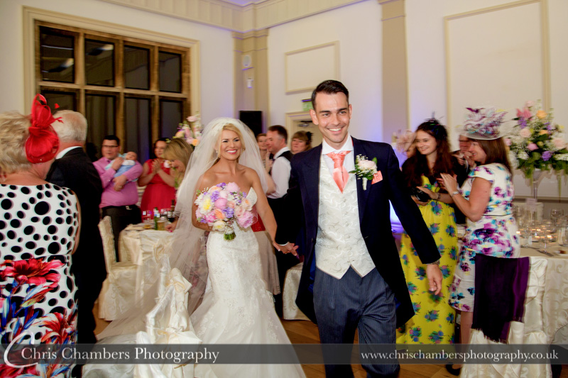 Bride and groom entering the pavilions at Hodsock Priory
