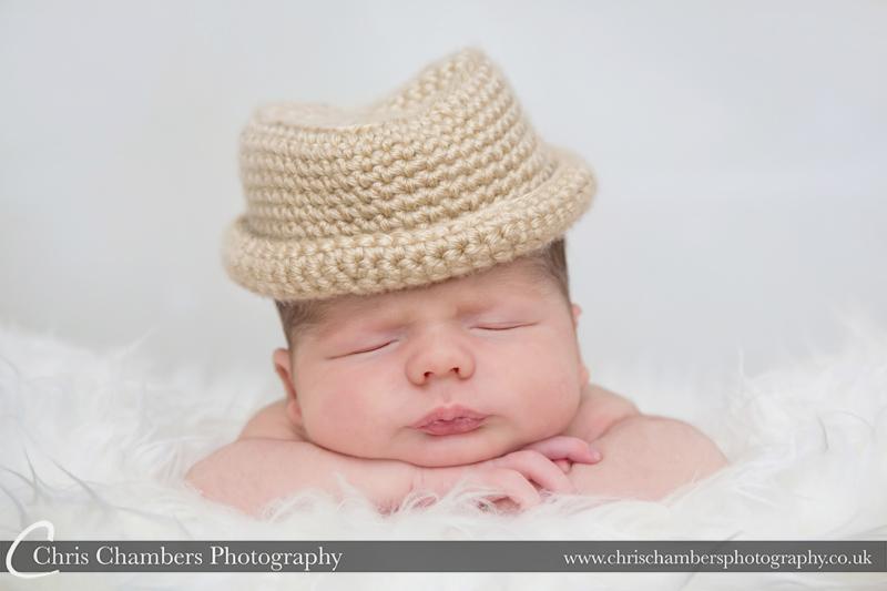 newborn baby posing ideas. baby wearing hat. Newborn baby posing