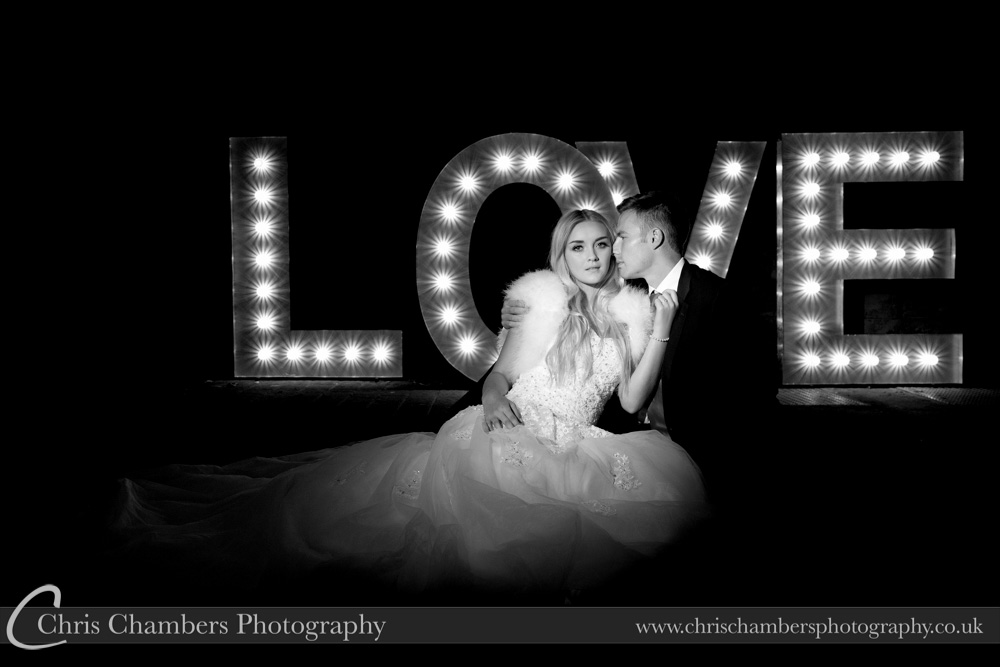 L.O.V.E. wedding letters with bride and groom