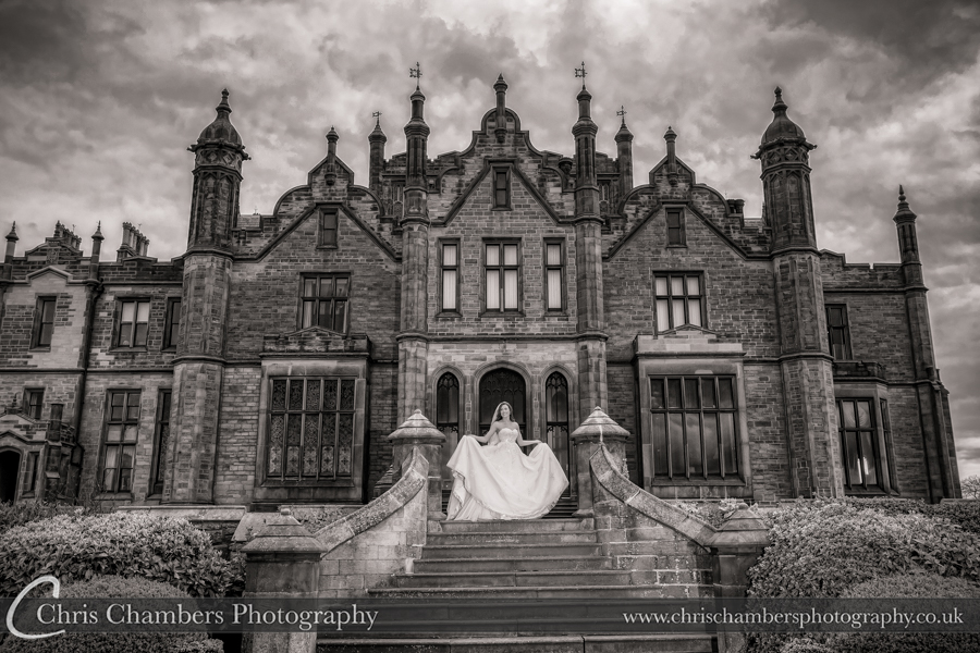 Wedding photography, Allerton Castle North Yorkshire. bride on the steps
