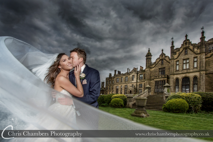 Brides veil blowing at Allerton Castle. Yorkshire wedding photography at Allerton castle